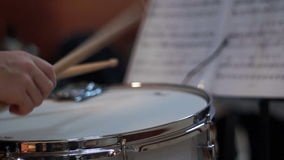 Boy playing drum in school stock footage