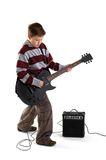 Boy playing an electric guitar isolated Stock Image