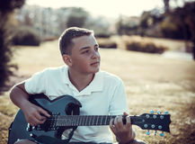 Boy playing electric guitar Stock Image