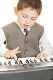 Boy playing electric piano Stock Image