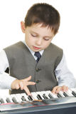 Boy playing electric piano Stock Photos