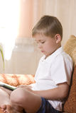 Boy playing an electronic game Royalty Free Stock Photography
