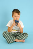 Boy playing with a electronic game Royalty Free Stock Photography