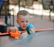Boy playing. Boy with enthusiasm playing air hockey Stock Images