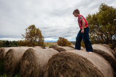 Boy Farm Bales Royalty Free Stock Photos