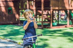 Boy playing with fidget spinner. Child spinning spinner on the playground. Blurred background Stock Image