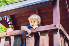 Boy playing with fidget spinner. Child spinning spinner on the playground. Blurred background Royalty Free Stock Photography