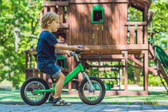 Boy playing with fidget spinner. Child spinning spinner on the playground. Blurred background Royalty Free Stock Photos