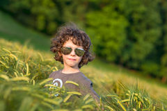 Boy playing on the filed in sunset, Thumbs up! Stock Photos