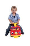 Boy playing on fire engine Stock Photo