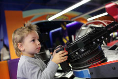 Boy playing a first person shooter Stock Images