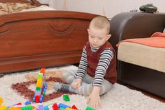 Boy playing on the floor Stock Photo