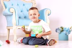 Boy playing on the floor royalty free stock images