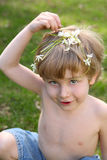 Boy playing with flowers Stock Photography