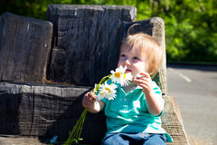 Boy Playing with Flowers Royalty Free Stock Photography
