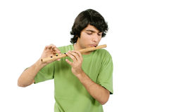 A boy Playing with flute Stock Images