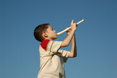 Boy playing the flute Royalty Free Stock Images