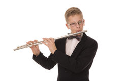 Boy playing a flute Royalty Free Stock Photography