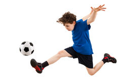 Boy playing football royalty free stock photo