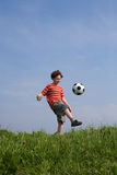 Boy playing football Royalty Free Stock Image