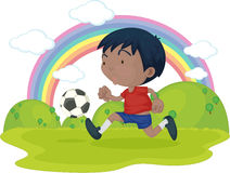 A Boy Playing Football Royalty Free Stock Photos