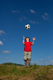 Boy playing football Stock Images