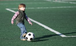 The boy playing football Stock Photos