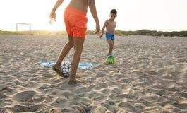 Boy playing football on the beach. Boy playing football  on the beach Stock Image