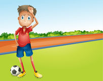A boy playing football Stock Photo
