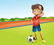 A boy playing football Royalty Free Stock Images