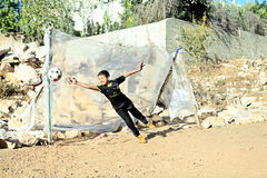 Boy playing football in Palestine Royalty Free Stock Photos