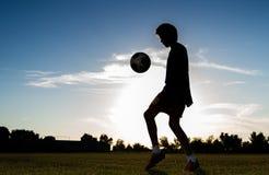 Boy playing football Stock Photography