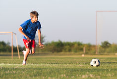 Boy playing football Royalty Free Stock Images