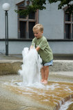 Boy Playing With Fountain Royalty Free Stock Image
