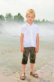 Boy playing in the fountain Royalty Free Stock Images