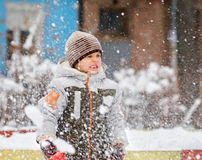 Boy Playing in Fresh Snow Royalty Free Stock Photography