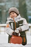 Boy Playing in Fresh Snow Royalty Free Stock Images