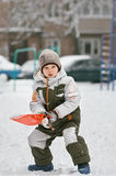 Boy Playing in Fresh Snow Royalty Free Stock Image