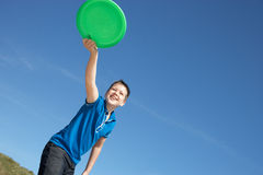 Boy playing frisbee on beach. Smiling Royalty Free Stock Photos