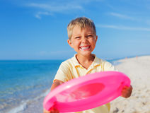 Boy playing frisbee Stock Photos
