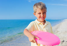 Boy playing frisbee Royalty Free Stock Photo
