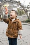 Boy playing frisbee gun Stock Photography