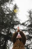 Boy playing frisbee gun Stock Image
