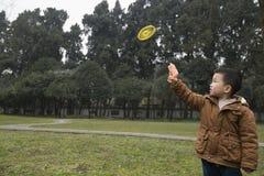 Boy playing frisbee gun Royalty Free Stock Image