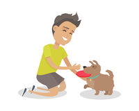 Boy Playing Frisbee with His Dog Stock Image