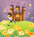 A boy playing in front of the castle Stock Image