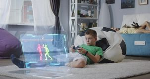 Boy playing futuristic video game