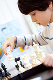 Boy playing a game of chess Royalty Free Stock Image