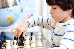 Boy playing a game of chess Royalty Free Stock Photos