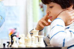 Boy playing a game of chess Stock Photography